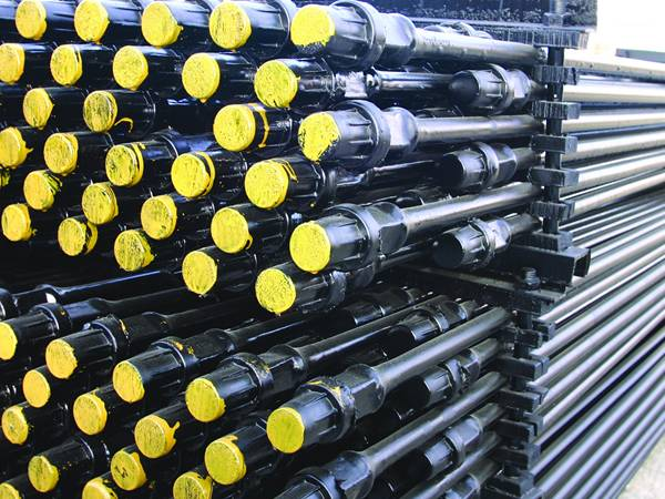 Two pallet of hollow sucker rods with the yellow color paint on the plastic caps.