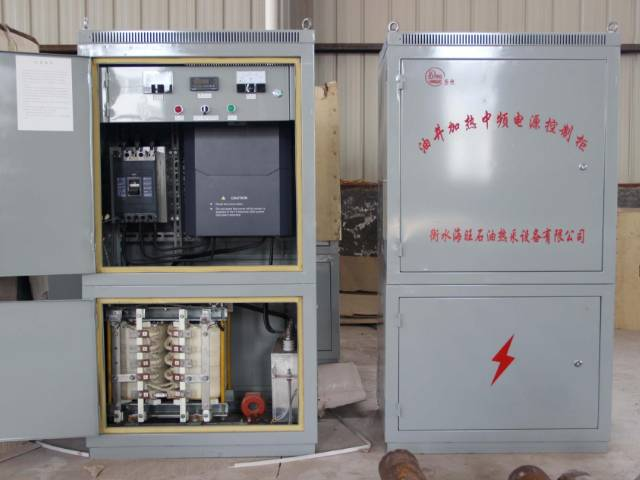 A opened and a closed middle frequency power control cabinet in the warehouse.