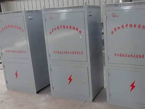 Three middle frequency power control cabinets on the ground.