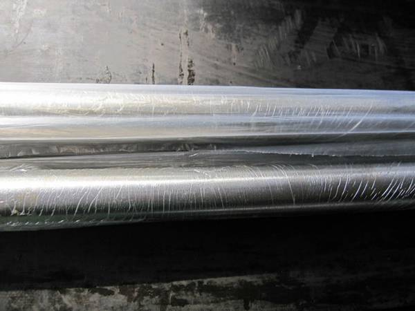 Two polished rod covered by the plastic film.