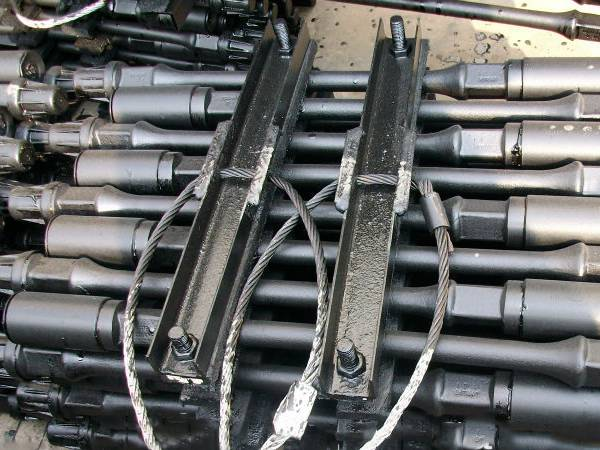 A bundle of sucker rod is packaged by the angle steel and bolts.